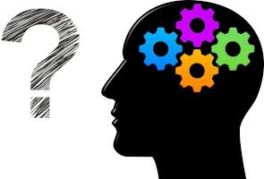 tête avec des rouages colorés qui se pose une question : psy ou coach ?